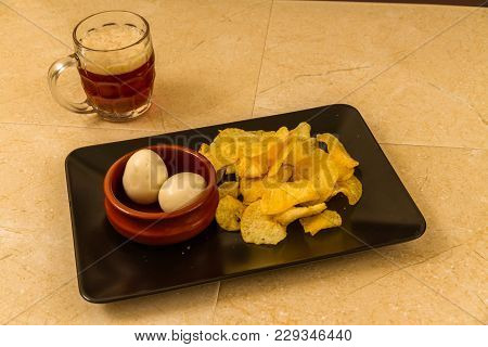 Two Pickled Eggs With Crisps Or Chips And Half Pint Of English Beer.