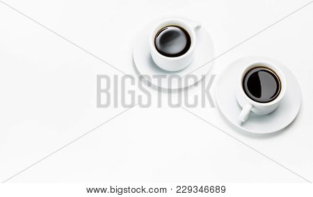 Two Cups Of Coffee Isolated On White, Top View.