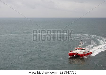 Modern Tugboat Of Red And White Color In The Sea.