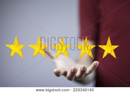View Of A Businessman Touching Technology Interface With Ranking Stars