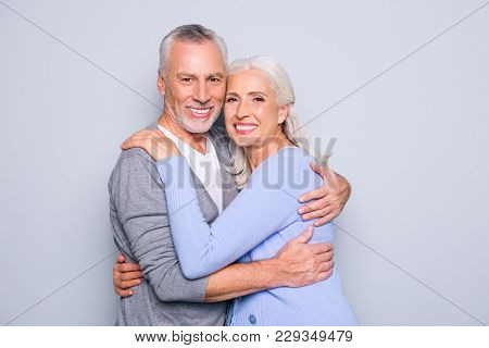 Portrait Of Delightful Tender Gentle Elderly Spouses Who Are Relaxing, Hugging, They Have Perfect Id