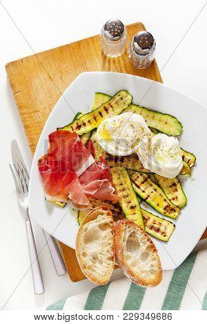 Healthy Summer Salad With Grilled Zucchini, Mozzarella And Prosciutto. Fresh Sliced Bread Ciabatta.