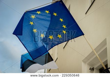 Eu, European Union, Flag - Flag Of Eu, European Union With A Flag Of Estonia Behind It