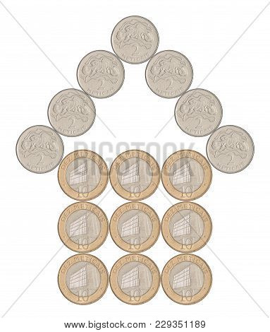 House Built From Mozambique Coins Isolated On White Background