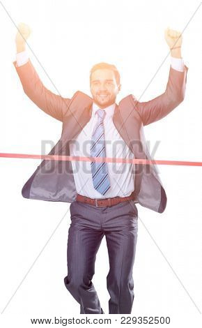 triumphant businessman in front of the starting tape
