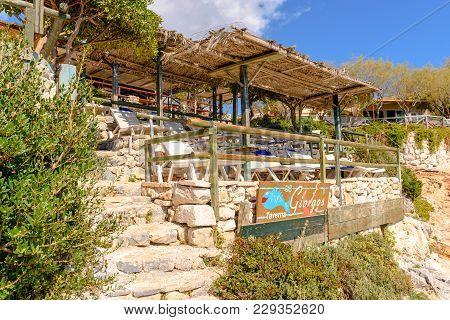 Zakynthos, Greece - October 1, 2017: Tavern Terrace At Porto Roxa Beach. Zakynthos Island, Greece
