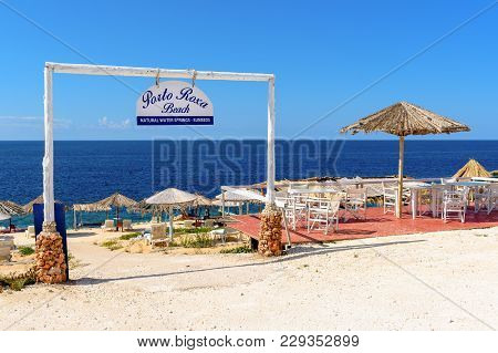 Zakynthos, Greece - October 1, 2017: Sunbeds And Parasols On Porto Roxa Beach. Zakynthos Island, Gre