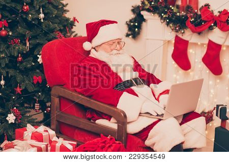 Close Up Of Santa, Study List Of Children's Wishes And Gifts On Device, Ready To Make Dreams Come Tr