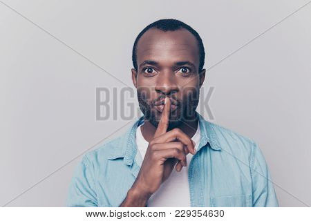 Just Don't Speak! Close Up Portrait Of Handsome Cheerful Mysterious Silent Man Making Hush Gesture,