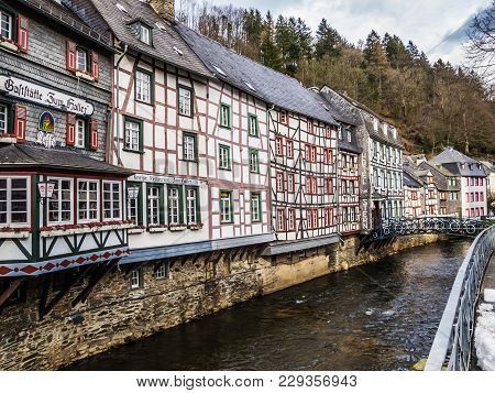 Monschau, Germany - March 18, 2013: Preserved Old Colorful Half-timbered Buildings Along The Rur Riv