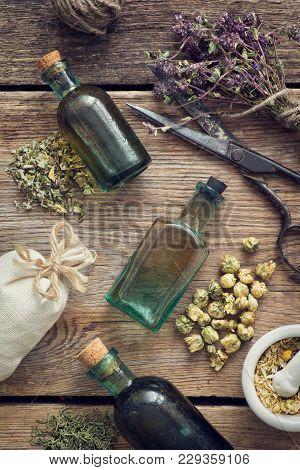 Tincture Bottles, Assortment Of Dry Healthy Herbs, Mortar, Sachet, Scissors. Herbal Medicine. Top Vi