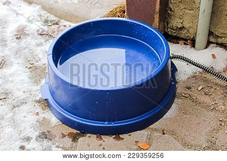 A Heated Dog Bowl Outside In Winter.