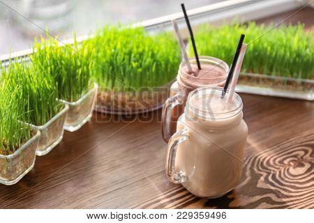 Mason jars with protein shakes on window sill in sport bar