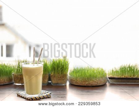 Glass with protein shake on window sill in sport bar