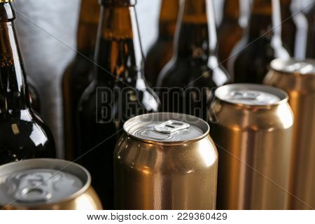 Fresh beer in cans and bottles, closeup