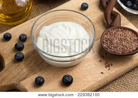 Cottage Cheese, Flax Seeds, Flax Seed Oil And Blueberries On A Table