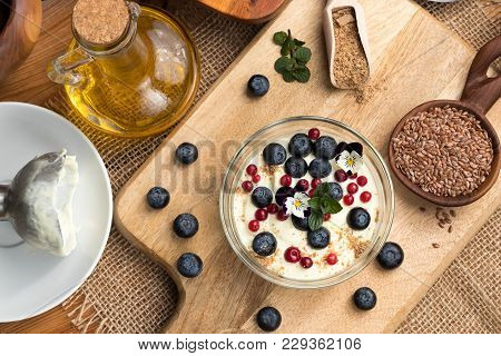 Cottage Cheese Blended With Flax Seed Oil, Topped With Fresh Blueberries, Frozen Wild Cranberries, E
