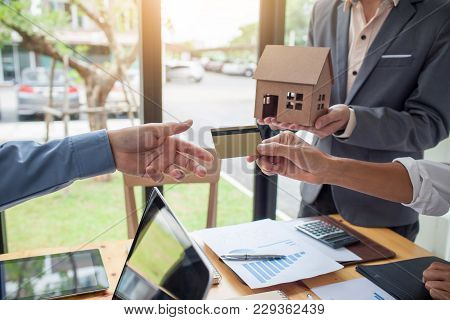 Hands Of Men Who Are Submitting Credit Cards To Customers, The Concept Of Home Loan With Credit.