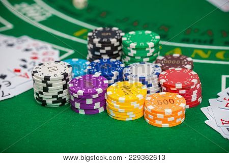 Dice Poker Chips And Banknotes On Table In Casino