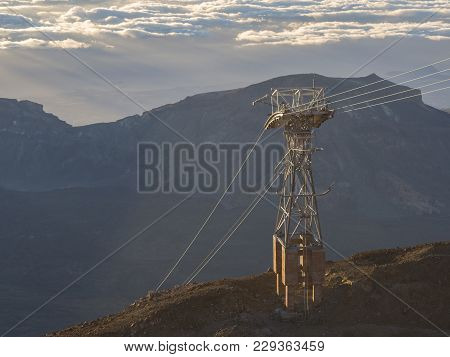 Pole Pylon Of Cable Car On Top Of Pico Del Teide Mountain In Tenerife Early Morning Light And Clouds