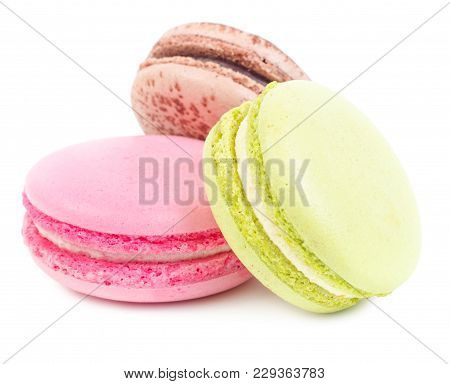 A French Sweet Delicacy, Macaroons Variety Closeup. Isolated On White Background.