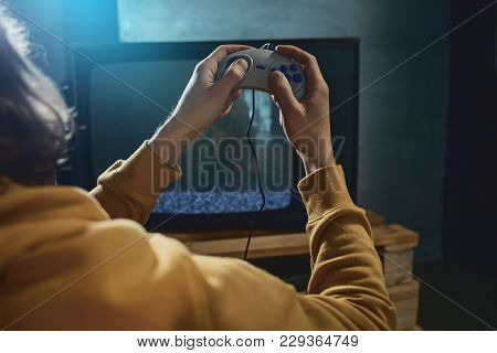 Close Up Male Hands Pressing Buttons On Joystick. He Watching At Screen Of Television. Fun And Appli