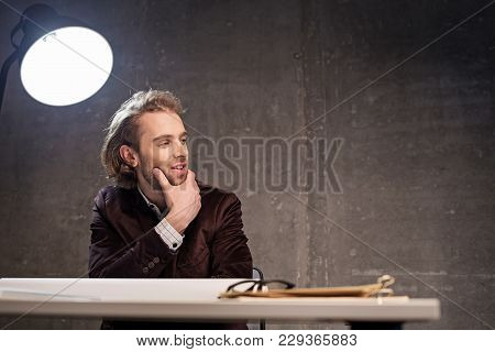 Creating New Project. Portrait Of Pensive Bearded Male Architect Sitting At Table. Wistful Employer