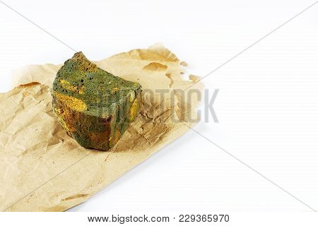 Half A Loaf Of Mouldy Rye Bread On Paper Isolated On White Background, Concept Of Inedible Products,