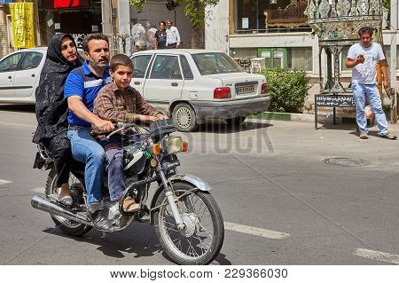 Kashan, Iran - April 27, 2017: A Family Of Three Iranians, Father, Mother And Son, A Teenager, Ride