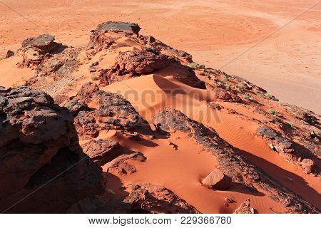 Red Stones Of Wadi Rum Desert In Jordan. Wadi Rum Also Known As The Valley Of The Moon Is A Valley C