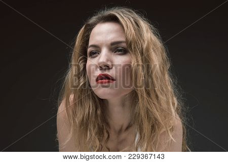Portrait Of Beautiful Calm Lady With Red Lips Looking Ahead Wistfully. Isolated On Background