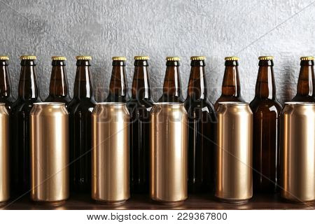 Fresh beer in cans and bottles on table