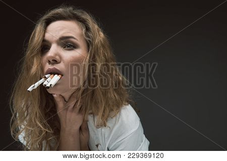 Sad Woman Touching Her Neck While Having Vomiting Reflex From Tobacco In Her Mouth. Copy Space In Ri