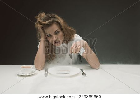 Portrait Of Tired Unhappy Woman Sitting With Ciggy In Hand With Lot Of Smoke Around Her. Copy Space