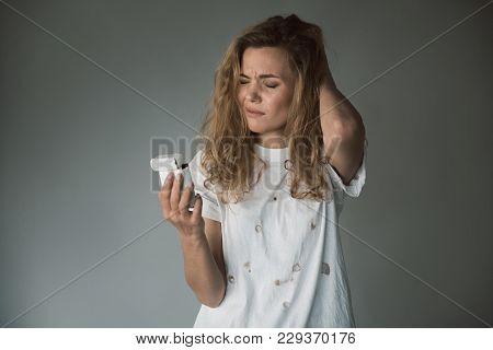 Waist Up Portrait Of Mad Girl Holding Opened Pack With Cigarettes. Her Face Expressing Pain. Copy Sp