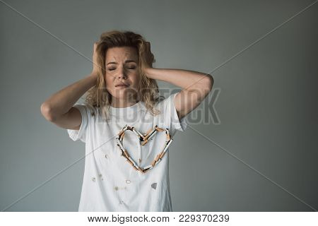 Waist Up Portrait Of Depressed Woman With Closed Eyes Holding Hands On Head. Copy Space In Right Sid
