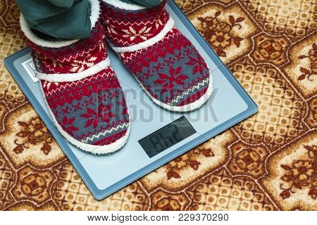 Person Feet In New Year Shoes Standing On Weight Scales