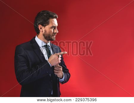You. Waist-up Profile Of Serious Young Elegant Businessman In Suit Is Standing And Pointing Finger A