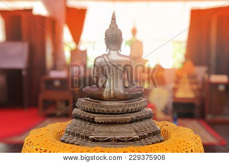 Buddha Meditating On A Lotus Base 5 Step.  Photographed From Behind