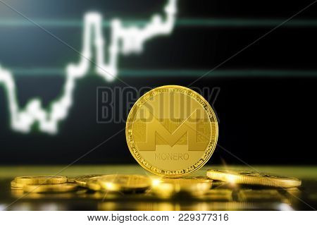 Monero (xmr) Cryptocurrency; Gold Monero Coin On The Background Of The Chart