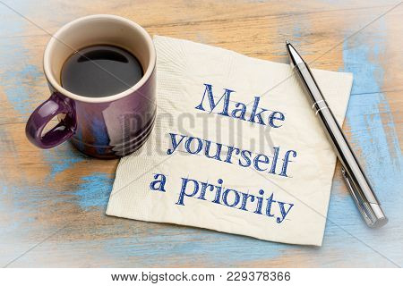 Make yourself a priority advice - handwriting on a napkin with a cup of espresso coffee