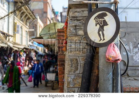 KATHMANDU, NEPAL - CIRCA JANUARY 2017: Porter sign in a small street in the Basantapur area.