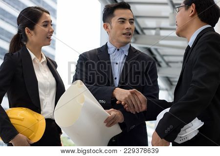 After Successful Bussiness And Construction, Teamwork Of Bussiness And Engineering Shaking Hand