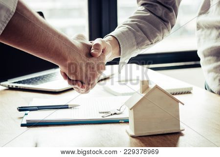 Successful Agreement , Estate,home Buying Contract Concept, Buyer Shaking Hand With Bank Empoyees Af