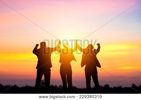 Team Work And Succes Concept, Silhouette Business People Corporate And Win