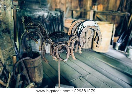 Happiness Talisman: Old Horse Shoes. Rusty Horse Shoes In A Ancient Forge. Old Ironmongery With Very