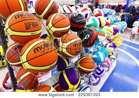 Yekaterinburg, RUSSIA - NOVEMBER 24, 2013: Colorful soccer balls inside Sportmaster Sport Store