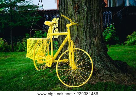 Stunning Yellow Bicycle Parked Under The Tree In The Summer On A Green Lawn. Time For Creation. Peri