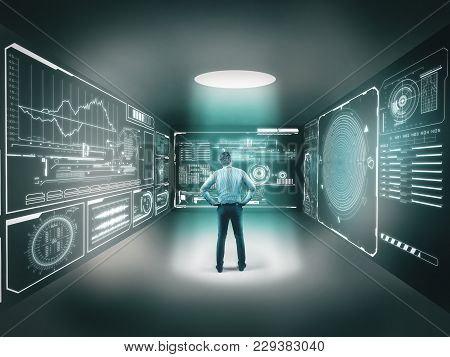 Businessman In Center Of A Room Looking To A Digital Maze, Izolated In A Room With Hi Tech Graphs An