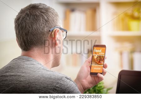 Hearing impairment man ordering food online by smart phone. Concept of ordering food in office, workplace or home.